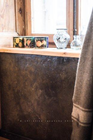 rendu béton ciré sur contrecoeur de boiserie ancienne
